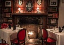 intimate restaurant setting with fireplace